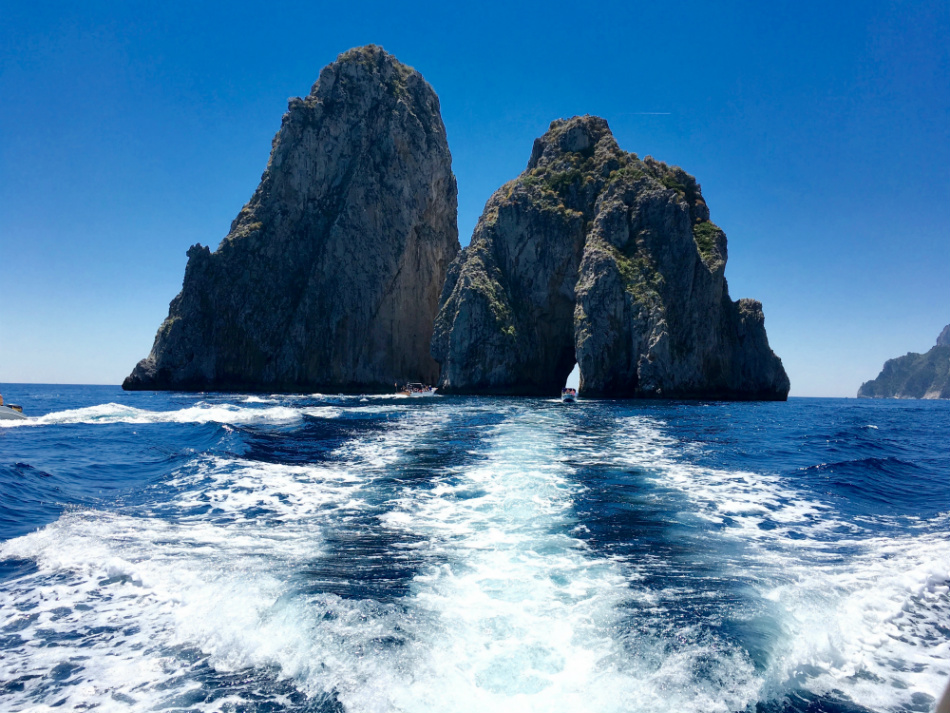 Day trips near the Amalfi Coast - Fariglioni of Capri - by Isaac Myers