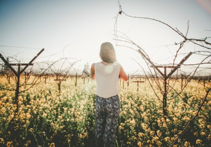 Woman walking into vines - by Ana Gabriel (unsplash)