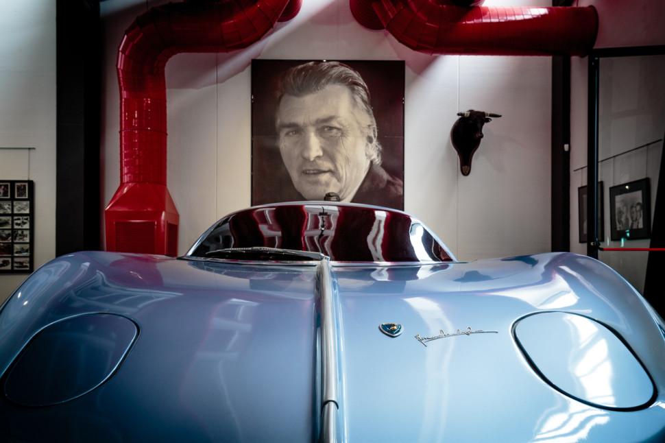 A vintage light blue Lamborgini in a car museum
