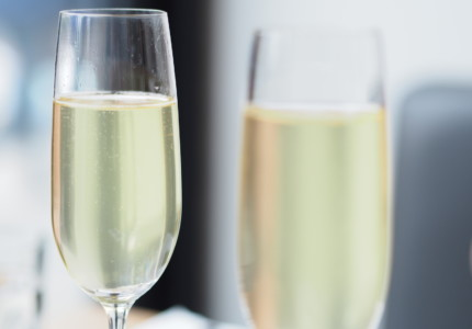 two flutes of pale prosecco