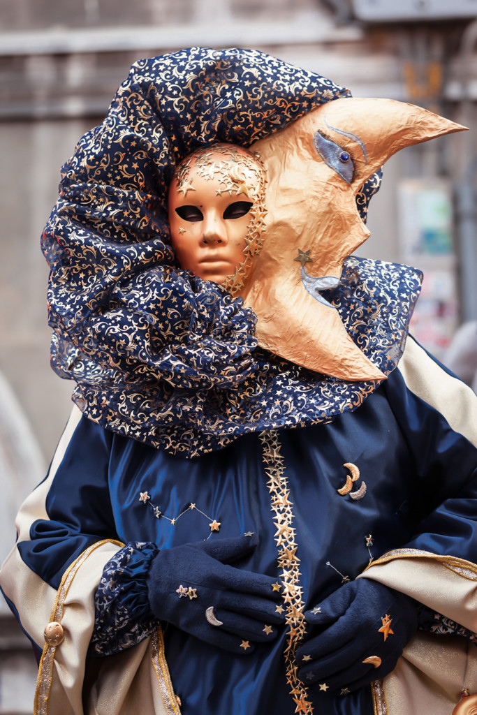 a costumed character at venice carnival