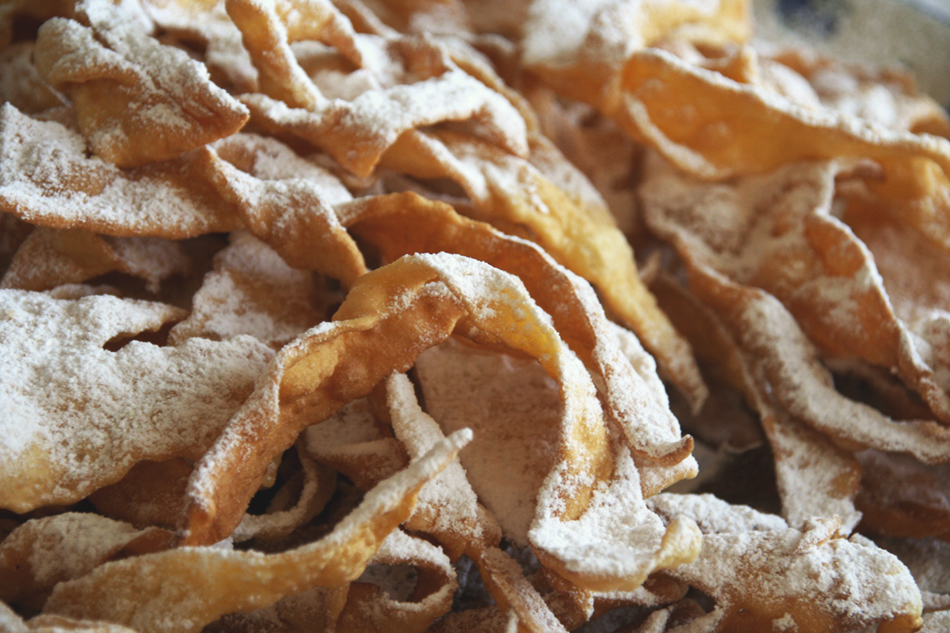 a close up of a pile of chiacchiere, an italian carnevale sweet
