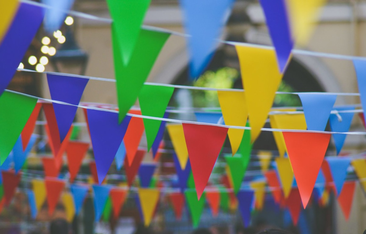 Rows of colourful bunting flags at Italian food festivals